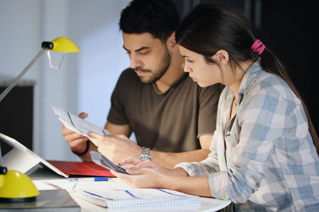 Man and Woman Worried For Taxes And Family Budget