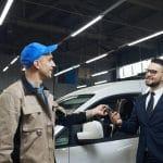 Client Giving Car Keys To Repairman