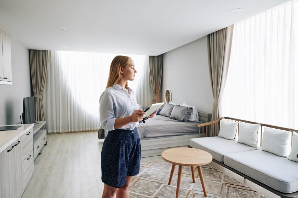 Young woman in studio apartment
