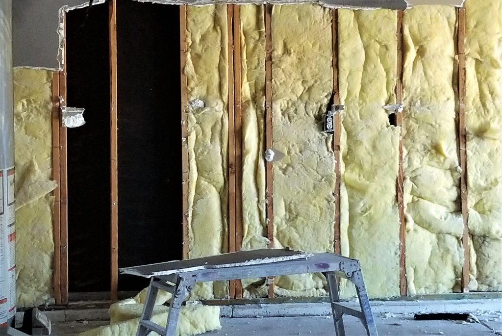 Construction of a Building, Adding Insulation to the Walls for Warmth!