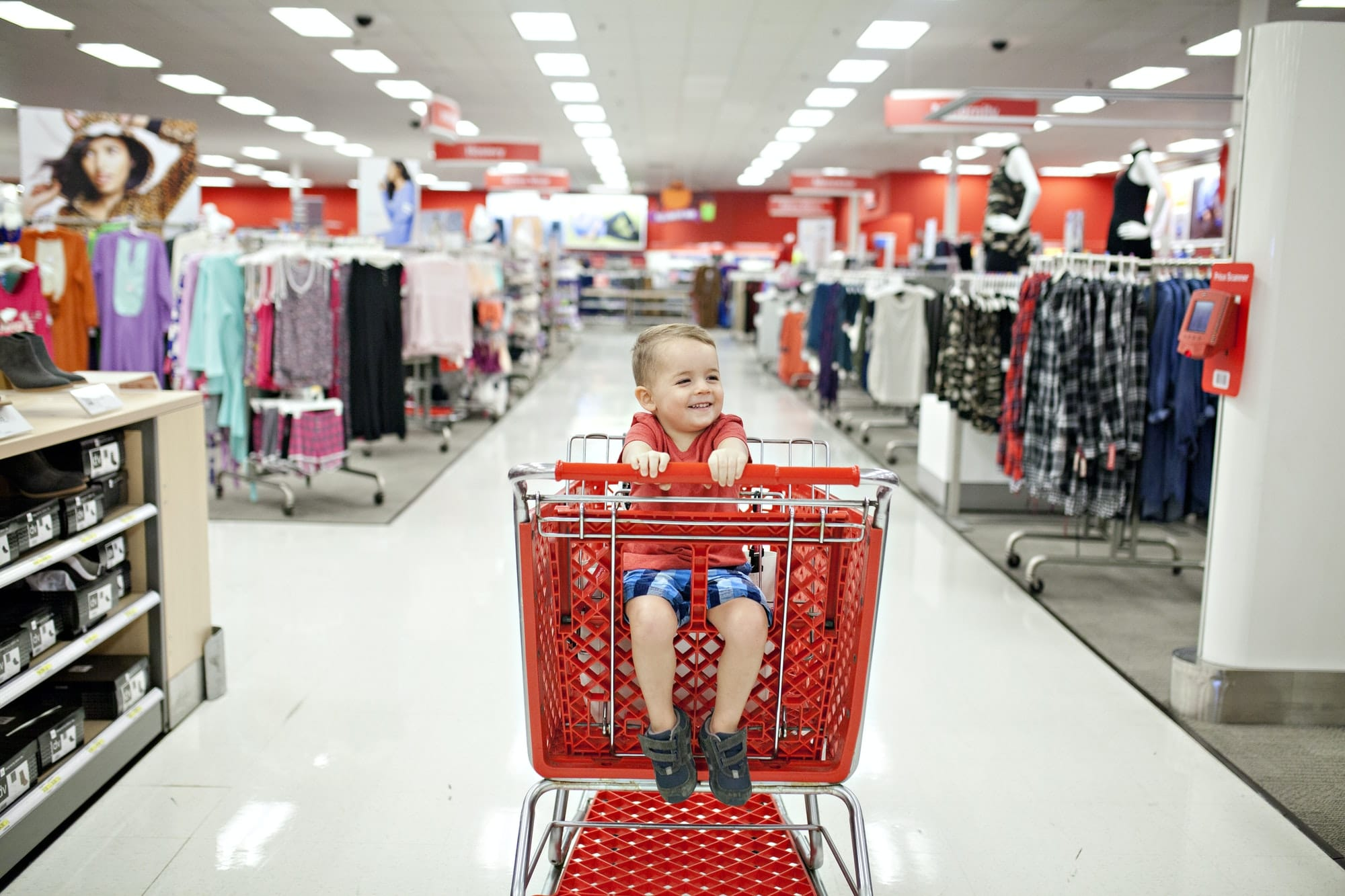 Little boy in target shopping cart at the store.