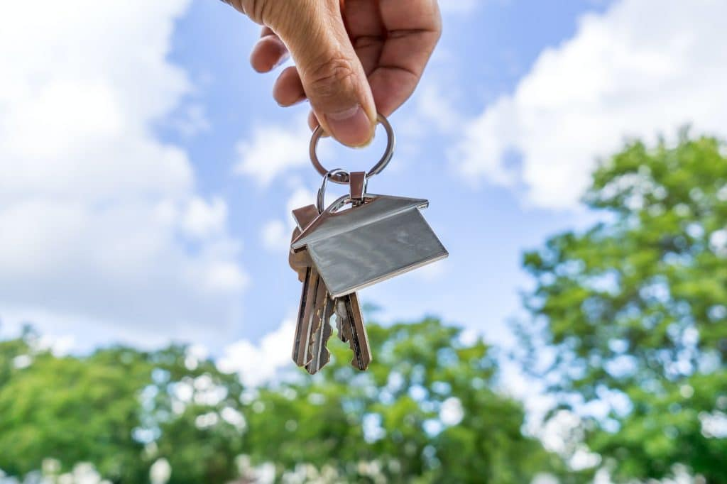 Real estate agent holding a house shape keychain