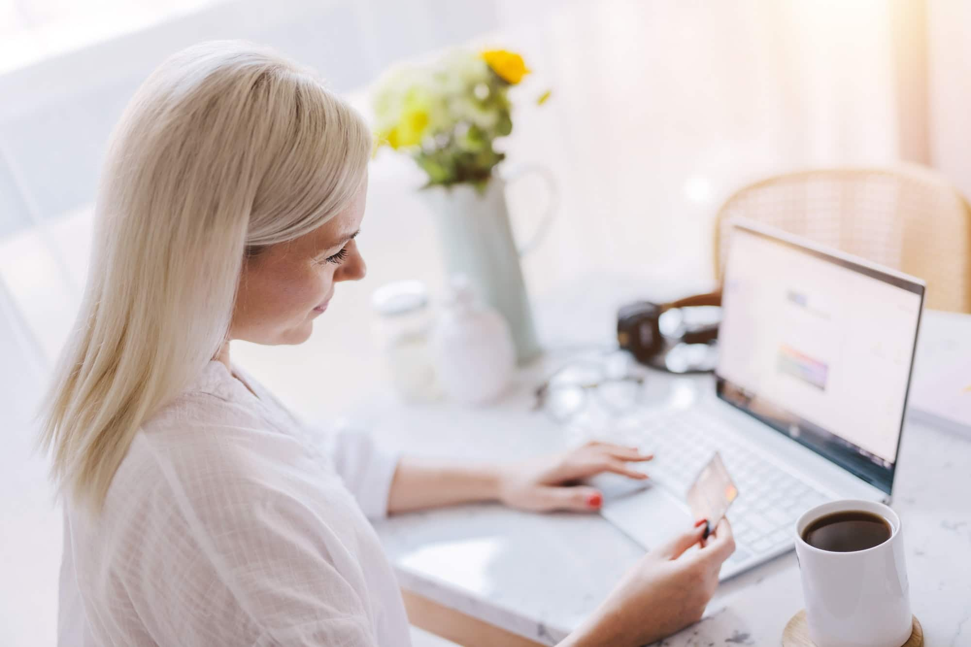 Woman paying online with her credit card.