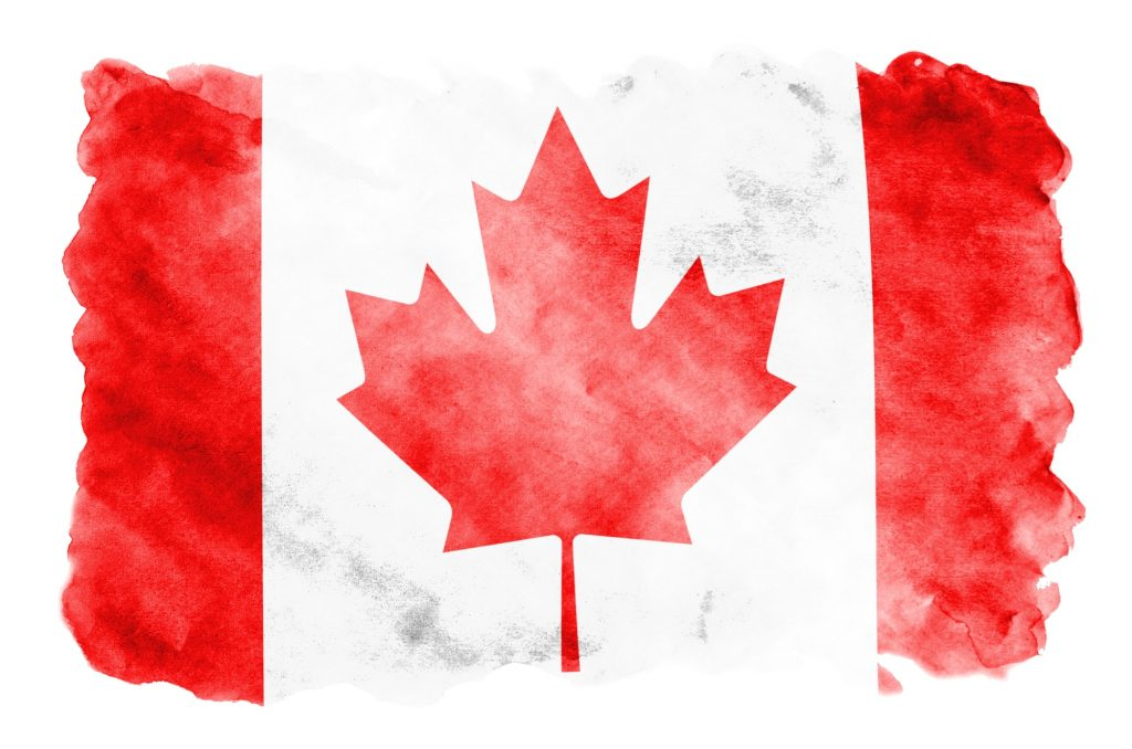Canada flag is depicted in liquid watercolor style isolated on white background