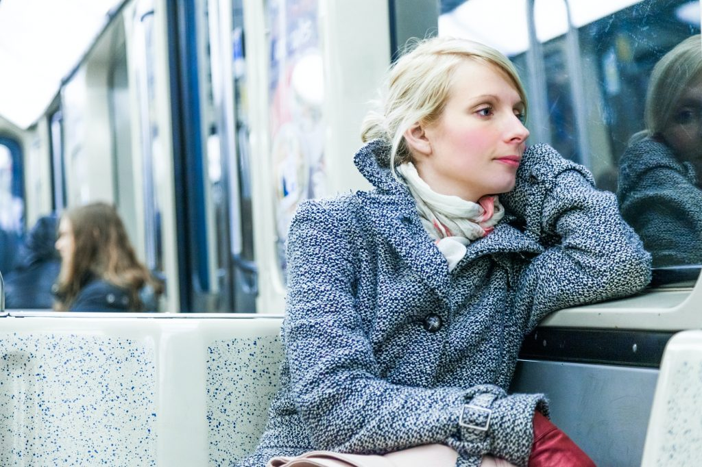 Young Woman Sitting inside a Metro Wagon