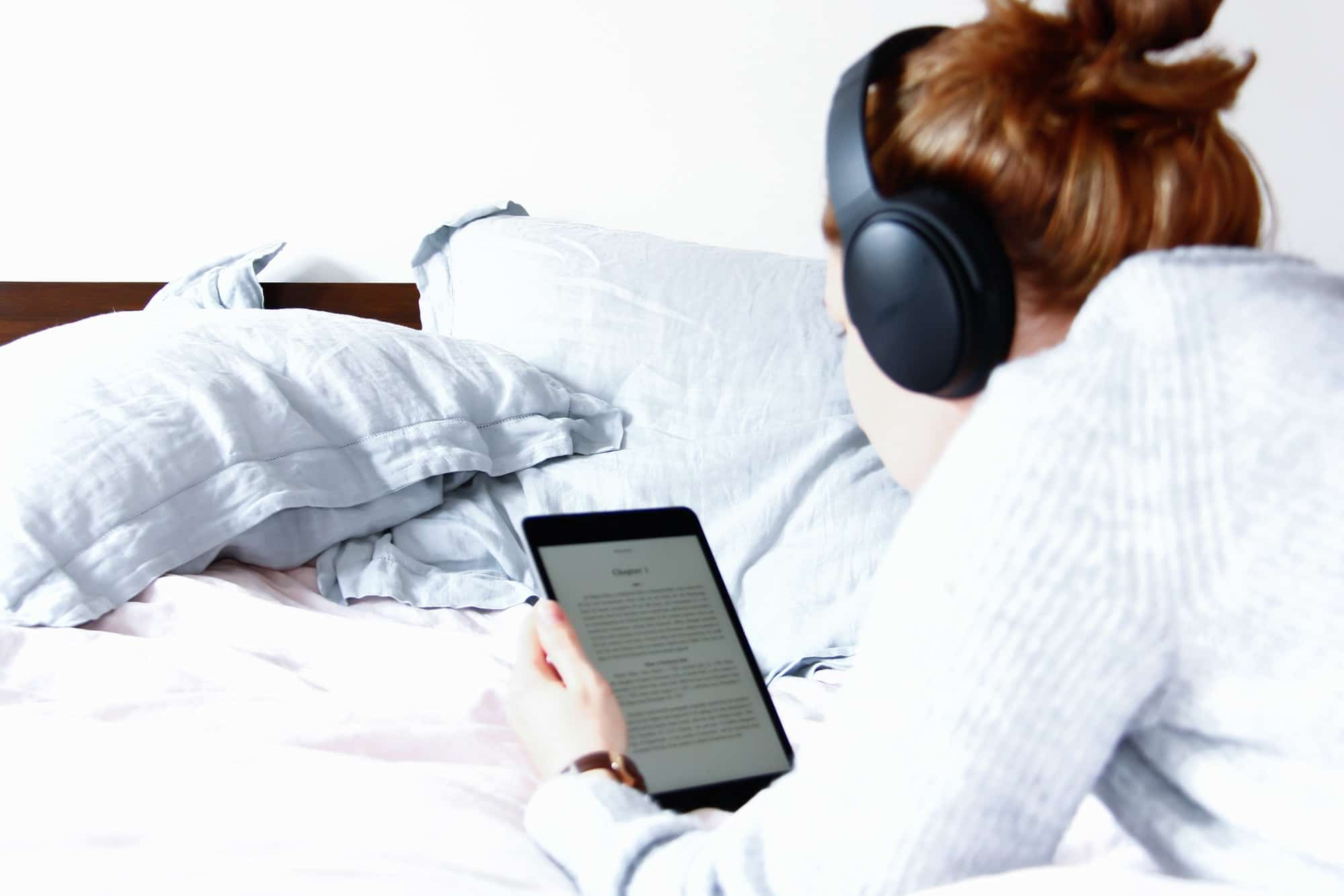 Woman reading kindle in bed