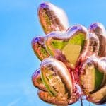 Bunch of Heart shaped ballons on the sky background