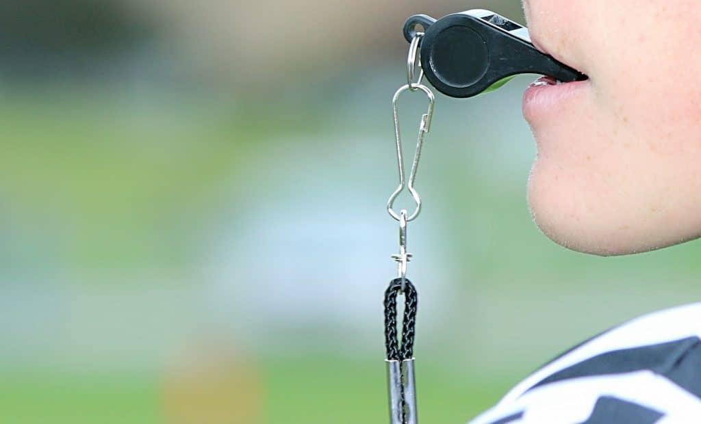 Minimalist image of young football referee.