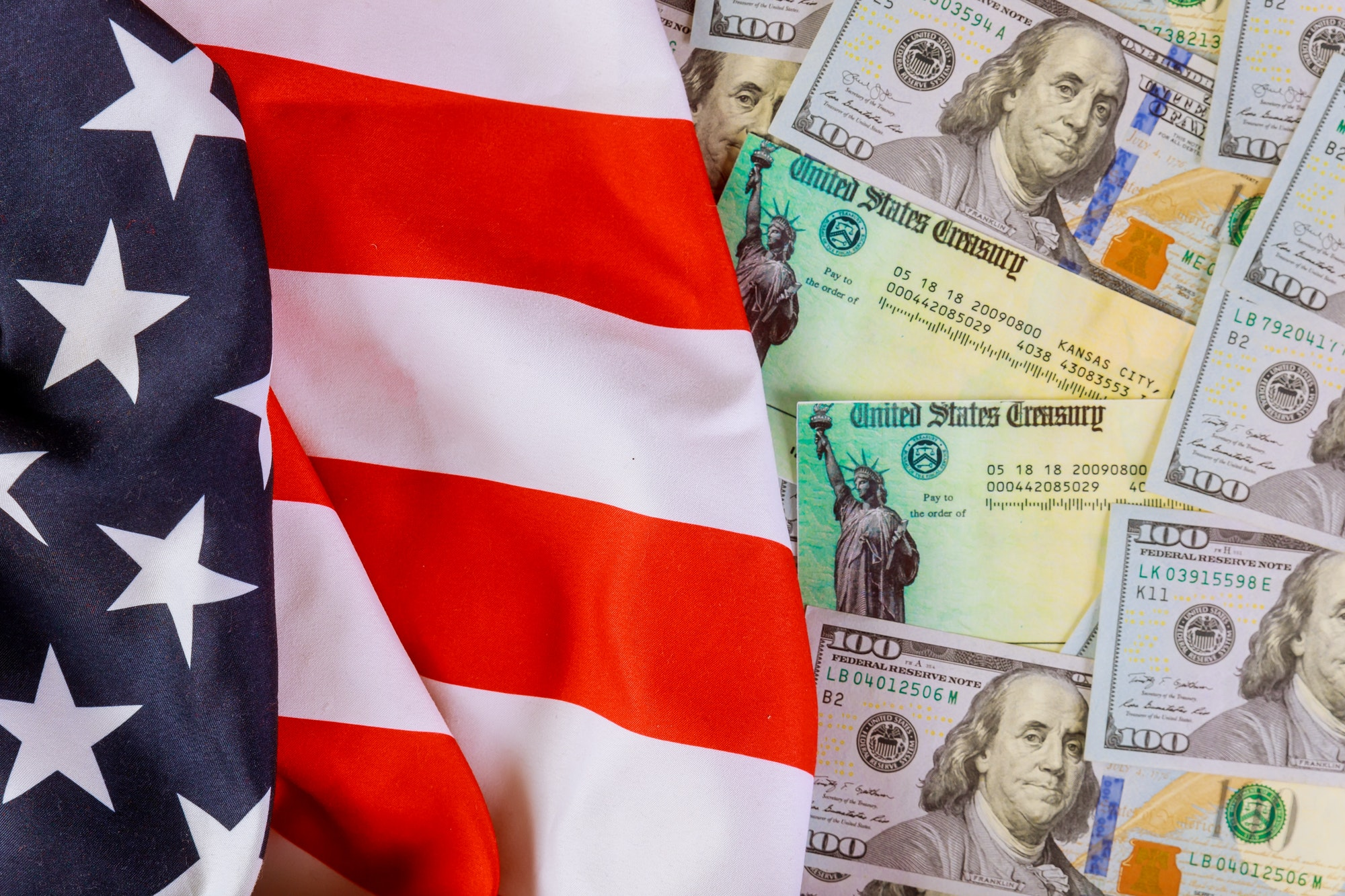 Stimulus American economic tax return check with US flag and USA dollar cash banknote