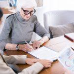 Senior woman writing testament