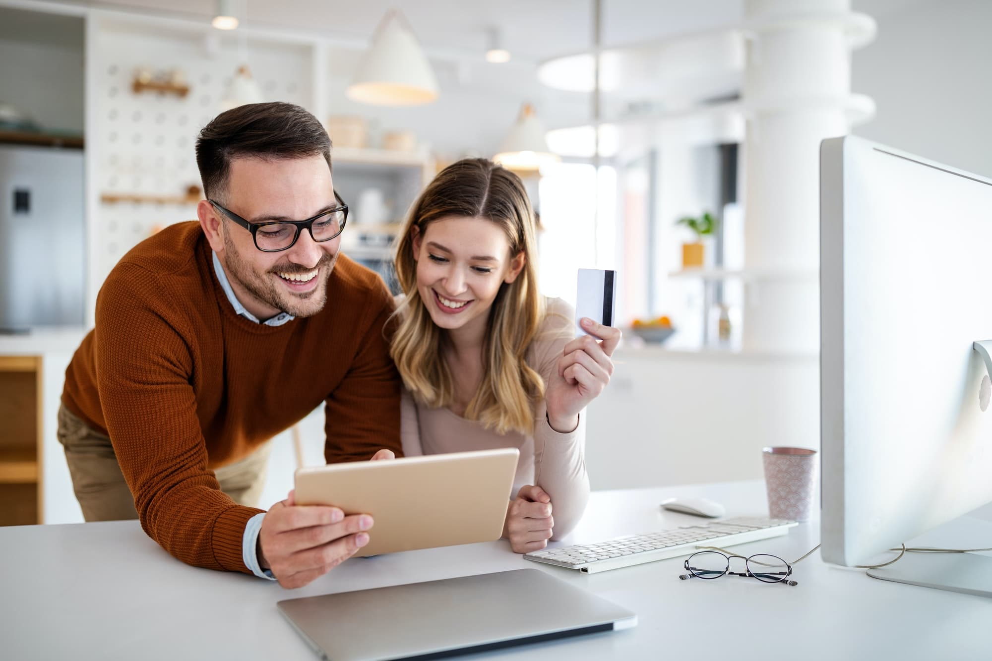 Portrait of a cheerful couple shopping online. Technology, e-commerce, banking concept