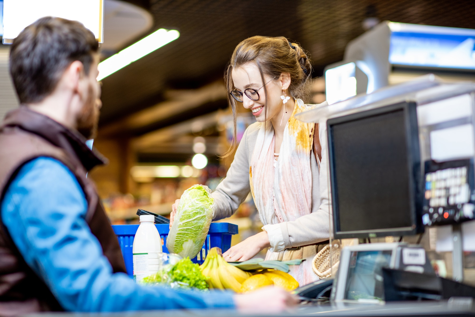 Woman on the cash register with cashier in the supermarket