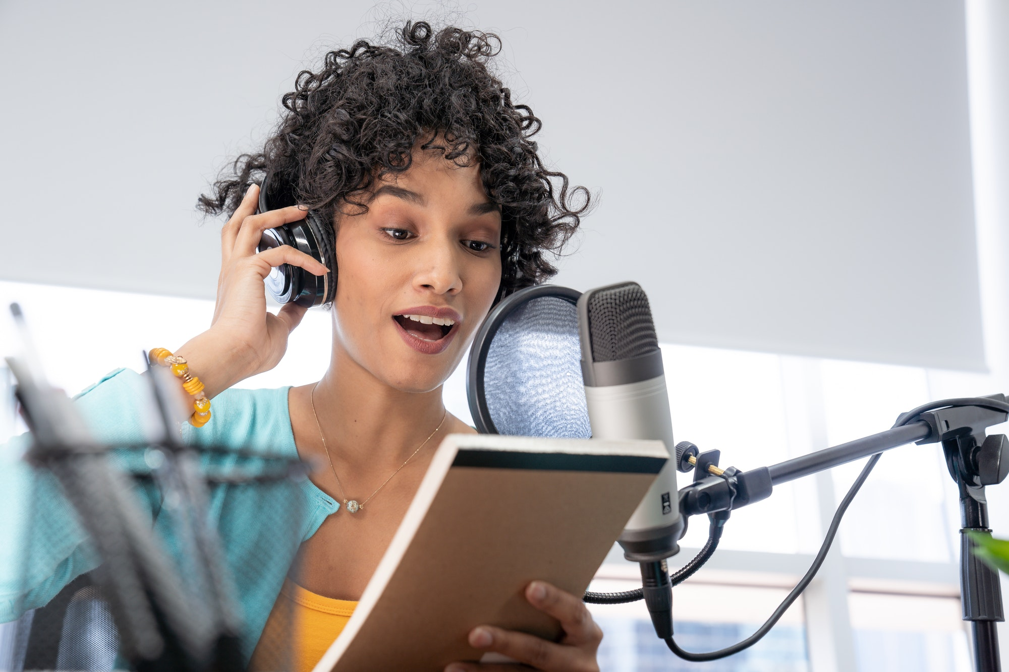 Young Black Woman Podcast Reading Her Script