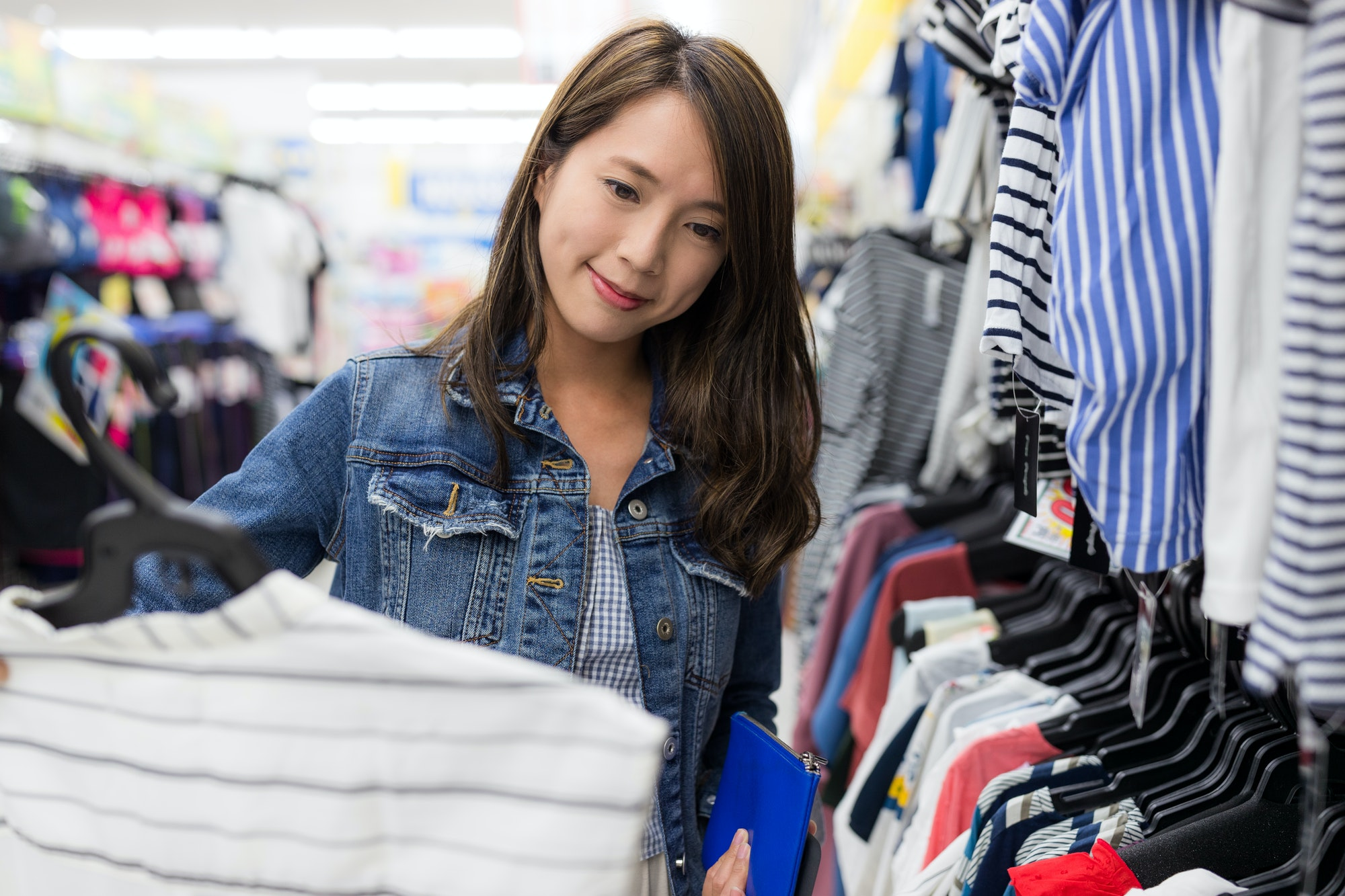 Woman buy clothes in boutique